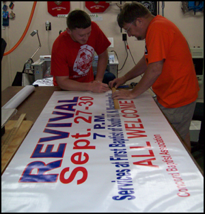 Kenny and Chris finishing up a banner